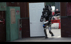 An IHMC Robotics robot opens and goes through a door during the 2015 DARPA Robotics Challenge in Pomona, Calif., on June 5.