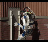 Team KAIST's robot sticks a plug into an outlet for the surprise task at the 2015 DARPA Robotics Challenge in Pomona, Calif., on June 6.