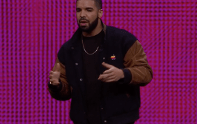 Drake came onstage in a vintage Apple logo jacket to help announce the new Apple Music.
