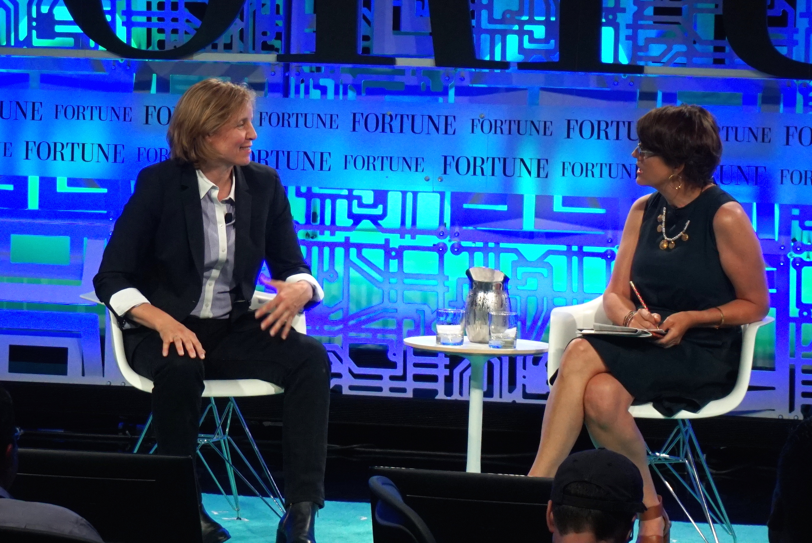 White House CTO Megan Smith, onstage at Fortune's Brainstorm Tech conference speaking with author Kelly Corrigan (right).