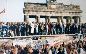 People on top of the Berlin Wall days before it was torn down