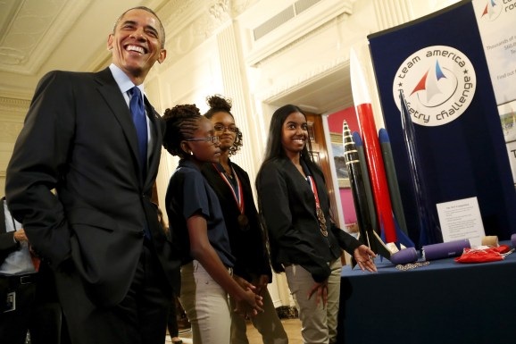 U.S. President Barack Obama (L) smiles as he speaks with members of the Team America Rocketry Challenge competitors representing the U.S. Virgin Islands as he plays host to the 2015 White House Science Fair at the White House in Washington, March 23, 2015. REUTERS/Jonathan Ernst - RTR4UJ3P