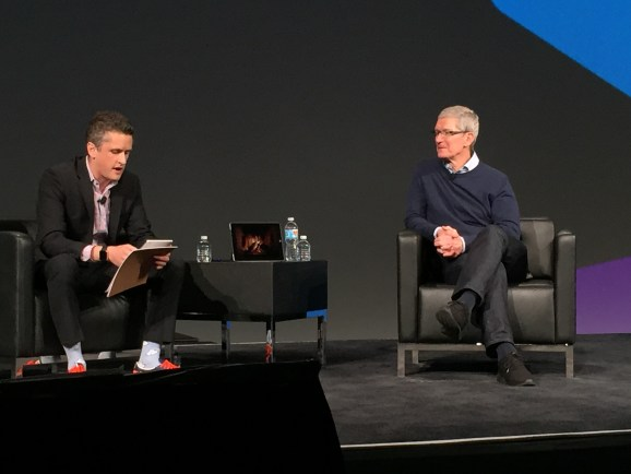 Apple chief executive Tim Cook speaks with Box cofounder and CEO Aaron Levie at BoxWorks 2015 on September 29.