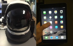 Space helmet on left, iPad Mini 2 on right.