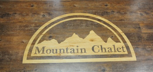 Mountain Chalet logo inlayed in the floor.