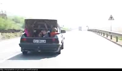 Driver carrying kids in trunk of car almost hit by a truck – YouTube