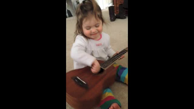 McKinley Plays Guitar