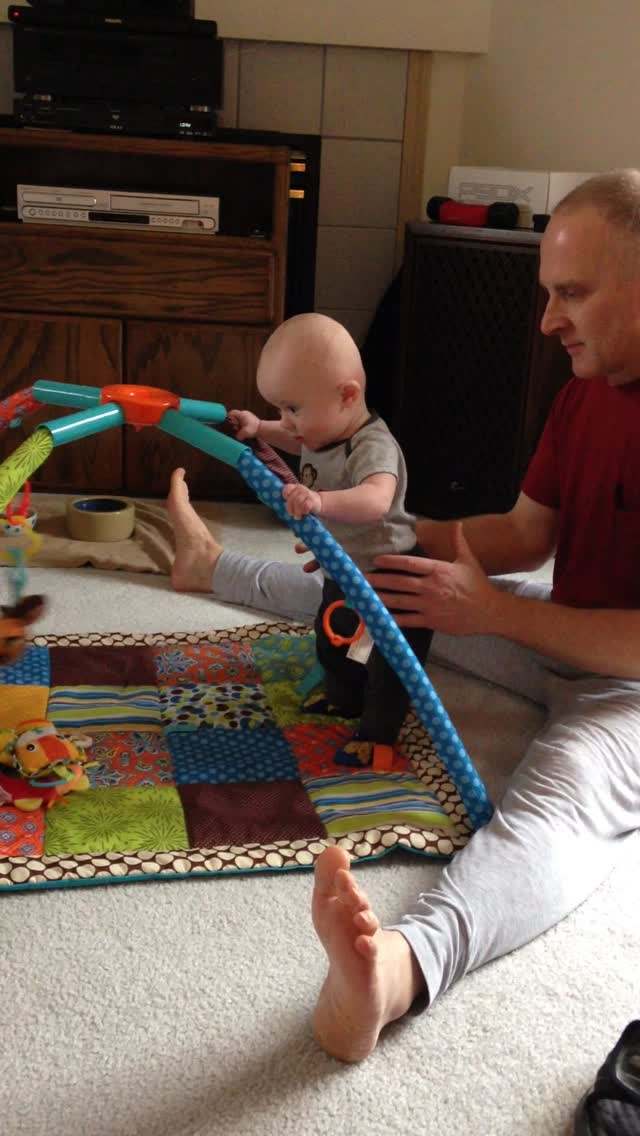 """Todd standing with play mat """"rails"""" – February 1, 2015 – IMG_1949"""