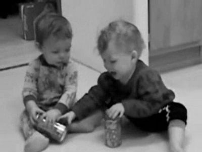 Babies fighting over Coke