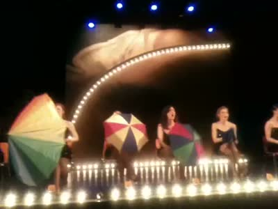 Alejandra looks awkward, as 8 women behave inappropriately with umbrellas&#8230;