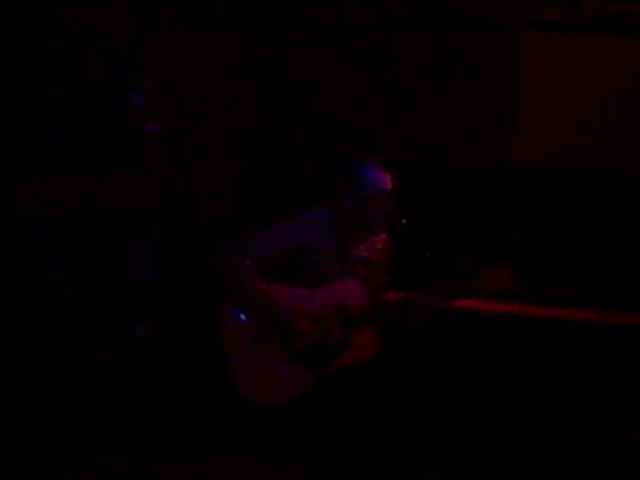 Cool guitar player tapping at the Tennessee bar in Paris