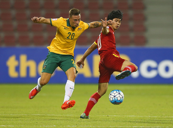 DOHA, QATAR - JANUARY 17:  Nguyen Cong Phuong of Vietnam battles with Alexander Gersbach of Australia during the AFC U-23 Championship Group D match between Vietnam and Australia at Grand Hamad Stadium on January 17, 2016 in Doha, Qatar.  (Photo by Francois Nel/Getty Images)