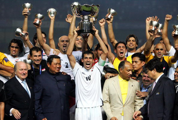 JAKARTA, INDONESIA - JULY 29: Younis Mahmoud of Iraq celebrates winning the AFC Asian Cup 2007 final against Saudi Arabia with his team mates, at Gelora Bung Karno Stadium july 29, 2007 in Jakarta, Indonesia. (Photo by Koji Watanabe/Getty Images)