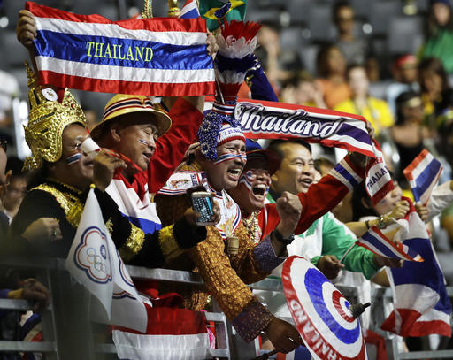Fans cheer on athletes from Thailand during the women's 58kg weightlifting competition at the 2016 Summer Olympics in Rio de Janeiro, Brazil, Monday, Aug. 8, 2016. (AP Photo/Mike Groll)