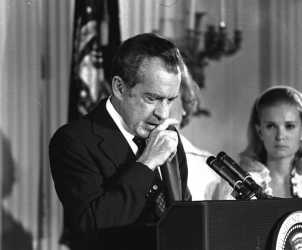 Richard Nixon performs the last acts of his devastated presidency in the White House East Room, August 9, 1974, as he bids farewell to his Cabinet, aides, and staff.  Nixon said only a man in the deepest valley can know how magnificent it is to be on the highest mountain.  (AP Photo)