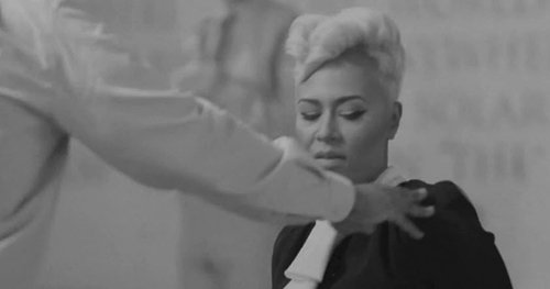 As a man steps up to Emeli, she gives a look saying &quot;Why you touching me for?&quot;