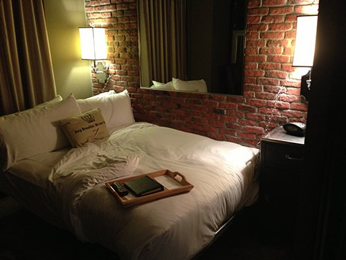 The room is about a third of the size of other rooms in the hotel. The mirror is embedded in the brick wall, leading some Redditors to think that it is actually a two-way mirror...