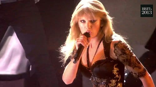 Taylor is now dressed in black, symbolizing her initiation. The 'good girl gone bad' narrative is complete, once again.