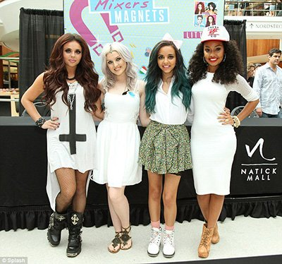 The UK girlband was formed by reality TV show XFactor. In a promo event, one of the members sports a big giant inverted cross. Satanic imagery is soooo in right now.