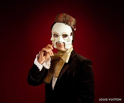 """This guy is wearing a multiple faced mask - a theme that appears to be a favorite in """"elite parties""""."""