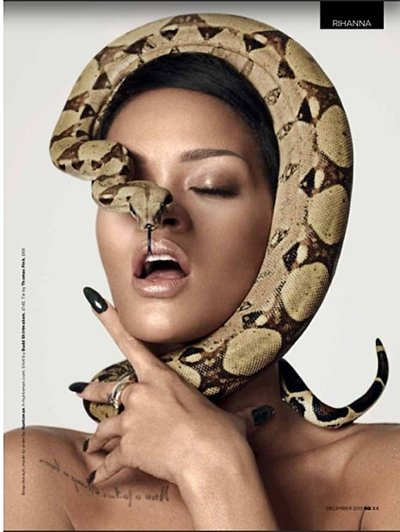 "In this pic, a snake almost strangles Rihanna while its head hides on of her eyes. Does this represent the ""stranglehold"" the industry has on her and other Illuminati puppets?"