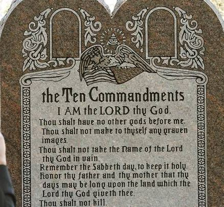 The Commandments are topped by the All-Seeing Eye inside a triangle, symbol of the occult elite.