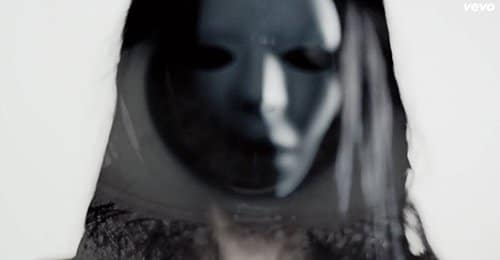 "Woman with a creepy ""Eyes Wide Shut""-type mask."