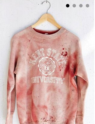 "This Urban Outfitters shirt is designed to be stained with blood, which is already slightly disturbing. What makes matters worse is that it is a ""Vintage Kent State Sweatshirt"". In 1970, Kent State University was the site of bloody shooting where four unarmed anti-war students were shot and killed by the National Guard of Ohio. What a sick was to commemorate an awful event. But what do you expect from the fashion world?"