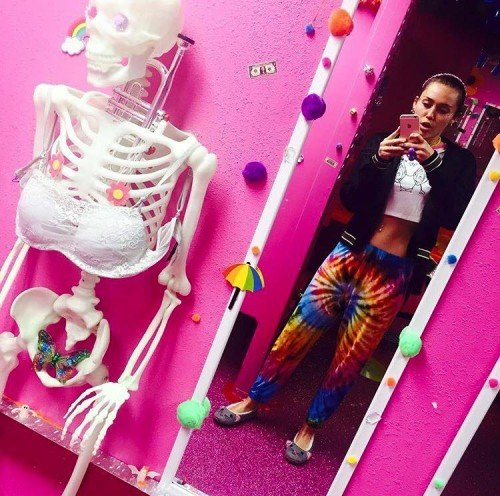Another industry slave is, of course, Miley Cyrus, who constantly posts MK-Ultra-themed pictures on Instagram. In this pic, we see a skeleton wearing a bra with a butterfly in the general area where the genitals would be. A great way to portray Beta Kitten slaves.