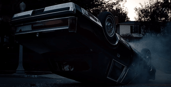 The trilogy begins with a black car that is upside down. This image becomes meaningful later on in the trilogy.