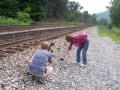 Picking up coal on a rural train track