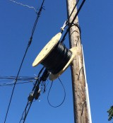 Fiber on a spool tied to another provider's strand.