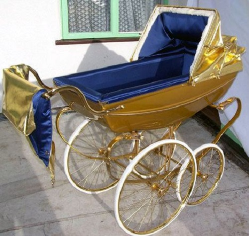 Ten unusual gold products. Gold baby carriage by British designers Graham Richardson and Alison Murfet