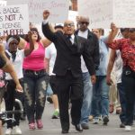 Tony Soto, Community Activist  leading the Protesters on the May 5  march for justice.