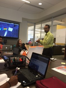 September 2, 2015: Soloman Negash, Executive Director of the Mobile Application Development Center (MAD), discusses  App ideas with interns.