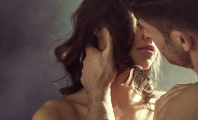 Sensual woman kissing her handsome husband couple Adobestock