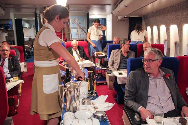The_Pan_Am_Experience_Stewardess_Serving_Drinks