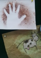 4th grade cave art. Powder tempera, charcoal, chalk and brown wrapping paper.