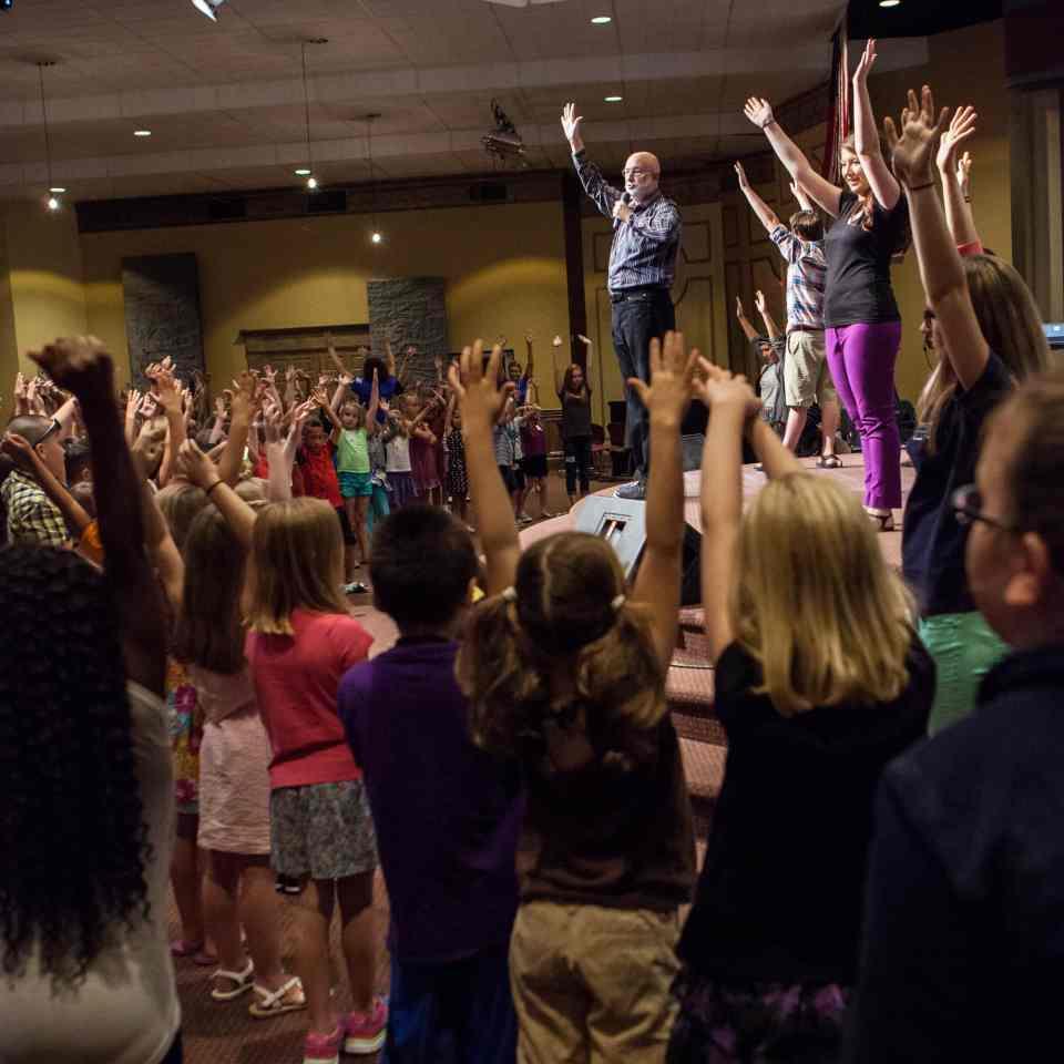 Voca lCoach Chris Beatty Teaching Kids hands up