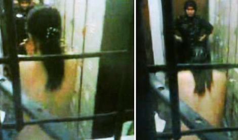 woman strips outside hotel