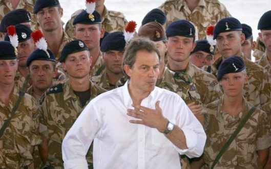 Prime Minister Tony Blair addressing troops in Basra, Iraq [Image: Stefan Rousseau/PA].