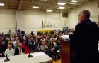 Shelburne Selectboard Chair Gary von Stange addresses a packed gymnasium Tuesday at the Shelburne Community School. Photo by Morgan True / VTDigger