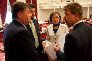 Party leaders Don Turner, Chris Pearson and Lucy Leriche meeting with Speaker Shap Smith at the podium. VTD/Josh Larkin