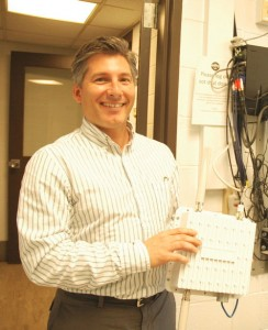 Al Levy, president of Summit Technologies, shows off a wireless repeater. VTD/Andrew Nemethy