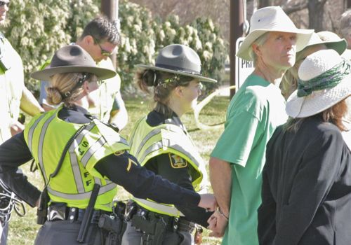 Police arrest the first protestors to cross the line onto Entergy property in Brattleboro. Photo by Alan Panebaker