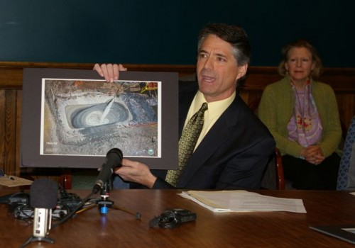 Paul Burns, executive director of VPIRG, holds up a photo of fracking. Photo by Andrew Stein/VTDigger