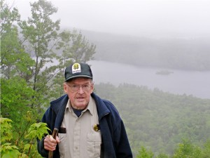 Lennie Waltrip admires the stunning view from Lennie's Lookout, which looks over Lake Dunmore to the Champlain Valley and the Adirondacks beyond. Photo by M. Dickey Drysdale