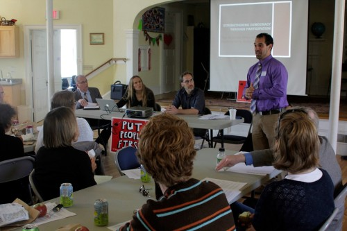 Vincent Villano, of the National Economic Social Rights Initiative, speaks about participatory budgeting in front of state legislators and advocates at the Unitarian Church in Montpelier on Tuesday, Sept. 17, 2013. Photo by Viola Gad/VTDigger