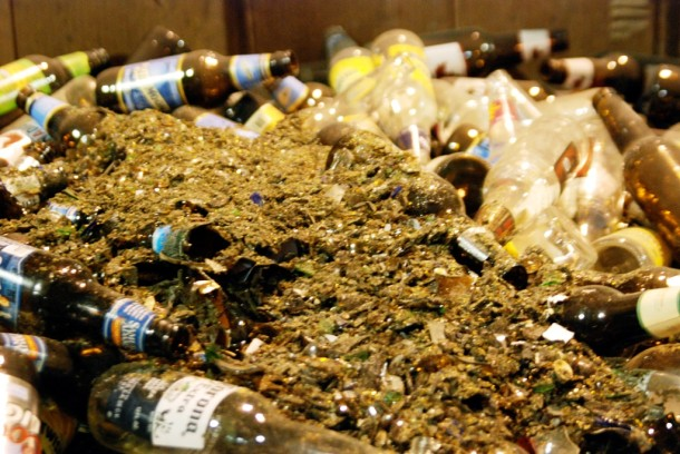 A bin full of mixed glass bottles at the TOMRA recycling facility in Essex Junction. Photo by John Herrick/VTDigger