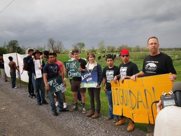 Demonstrators line the road near a Ferrisburgh farm. Migrant Justice photo